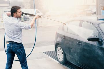 Man washing car in car wash station