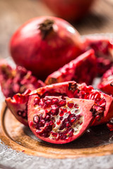 Pomegranate. Pieces of frest pomegranate on plate