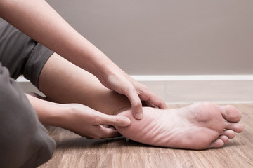 Female foot heel pain, plantar fasciitis