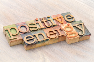 positive energy word abstract in wood type
