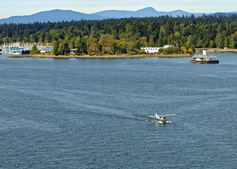 Taxying seaplane in Burrard Inlet, Vancouver, Canada