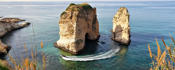 Beirut, Lebanon: A speedboat takes tourists around the famous Pigeon Rocks.