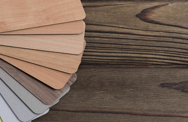 colored boards. choice of colors for the interior on a wooden background