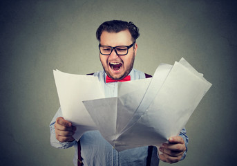 Man with papers looking angry
