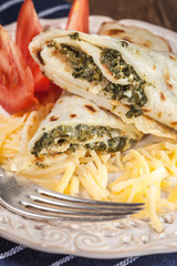 Crepes stuffed with cheese and spinach.