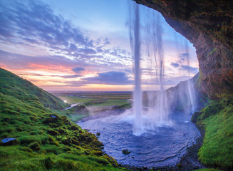 seljalandsfoss waterfall at sundown, iceland