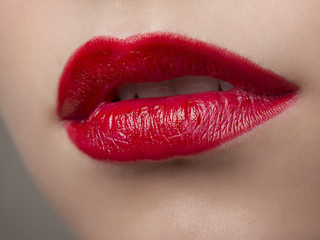 Lips in red lipstick close-up macro