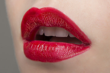 Red lipstick on the lips ajar