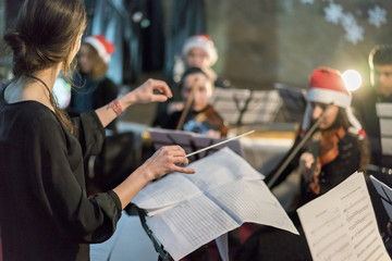 girl conductor conducting orchestra
