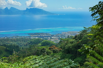 View from the mountains of the north-west coast of Tahiti with Moorea island in background, French Polynesia, south Pacific ocean