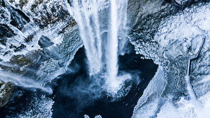 Ingelijste posters Watervallen Aerial photo of the Seljalandsfoss waterfall in winter