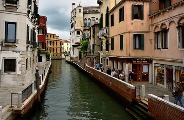 Toursits and the canal of Venice