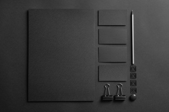 Blank items as mockups for branding on dark background