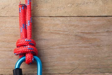 Fishermans Knot with Red Rope on Carabiner with copy space