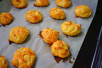 Baking a tray of French gougeres cheese puff choux in the oven