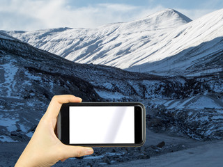 hand taking photo of nature view with a smartphone