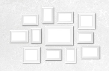 Blank photo frames collage, twelve set collection on textured wallpaper, interior decor mockup, gallery style. 3D illustration