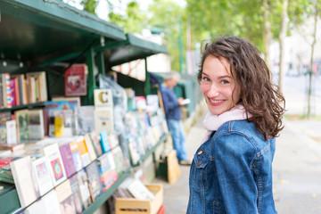 Portrait of a young tourist woman on Paris dock next to Notre Dame - Tourism and travel concept
