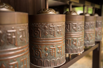 A row of prayer wheels in the Kodaiji temple, Kyoto, Japan
