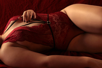Body of a chubby woman in red lingerie