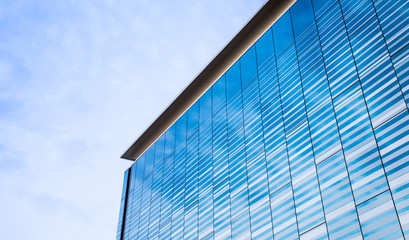 abstract photo of a modern glass building reflecting the sky