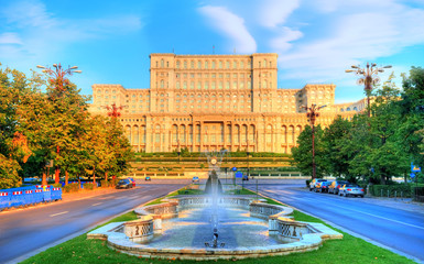 One of the famous and biggest building in the world Palace of Parliament illuminated by sunrise light in the most beautiful place of Bucharest, capital of Romania in Eastern Europe