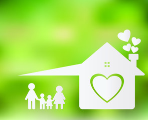 Happy family at home Mom and Dad stand holding hands with boys and girls. Home heart on the ground, blurred green background