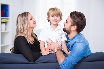 happy family portrait - young couple and cute little son