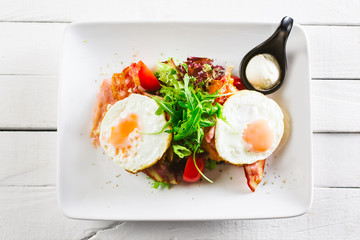 Sunny side up eggs and bacon
