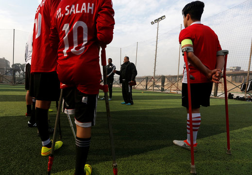 """Khaled Hassan, coach of """"Miracle Team"""", made up of one-legged, crutch-bearing soccer players, speaks to his team before a training session at El Salam club on the outskirts of Cairo"""