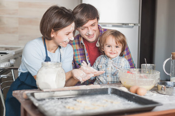 happy young family cooking with floor together at kitchen