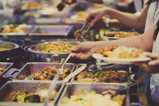 scooping the food. Buffet food at restaurant. Catering food