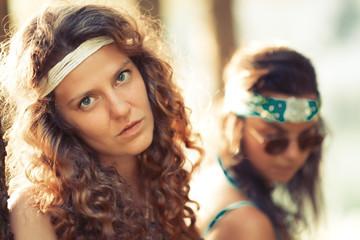 Pretty free hippie girls. Portrait- Vintage effect photo