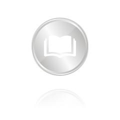 aufgeschlagenes Buch - Silber Münze mit Reflektion
