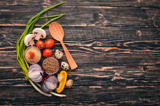 Vegetables, herbs and spices for cooking. Top view. The background of cooking. Free space for text.