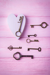 Happy Valentine's day.! Vintage keys collection and pink heart. Key Love and key Dream on the pink background. Top view, free space