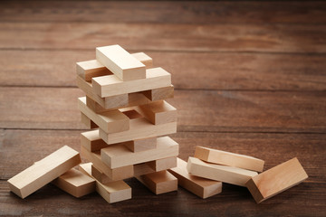 Wooden block tower game on brown table
