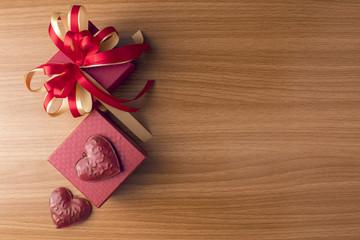 red gift box with heart love on wood ground in valentine concept