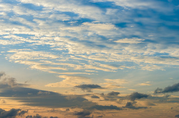 Wall Mural - There is a golden light below the horizon. dramatic sky with cloud at sunset,in the morning cloudy