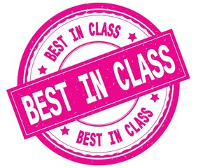 BEST IN CLASS , written text on pink round rubber stamp.