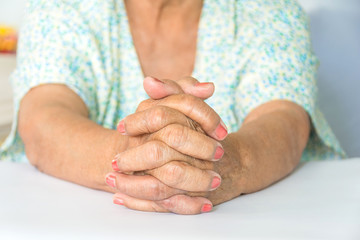 elderly woman hands praying to God