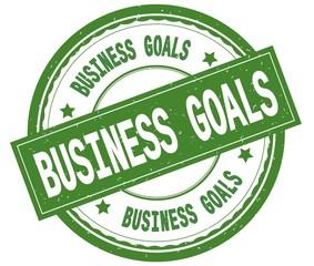 BUSINESS GOALS , written text on green round rubber stamp.