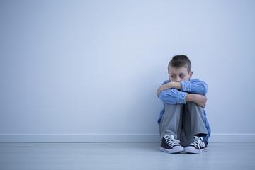 Sad alienated child with autism