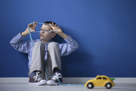 Autistic child playing blue gum