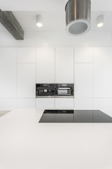 Spacious kitchen with designed hood