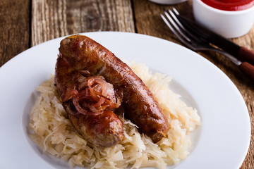 Sausages  and sauerkraut with caramelize onions