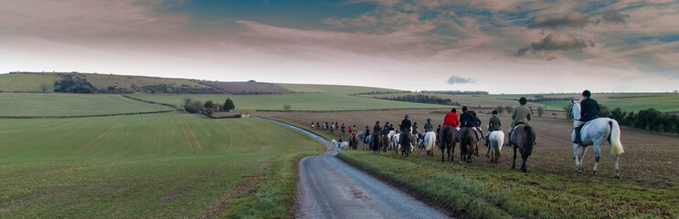 Printed kitchen splashbacks Khaki Panorama of Boxing Day hunt crossing South Downs landscape towards Old Winchester Hill iron age fort on a cold winters day with bright sunshine
