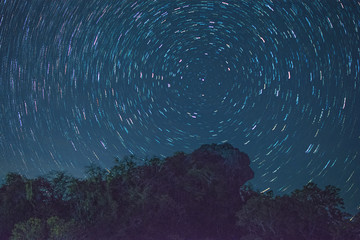 Star trail at Pha Hua Sing mountain in the night, The name of lion face rock in Thai language at Doi Samer Dao national park - Thailand