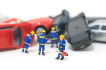 miniature rescue team are removing car crash from the road isolated on white background