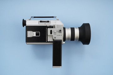 Super 8 Movie Film Camera on Blue Background
